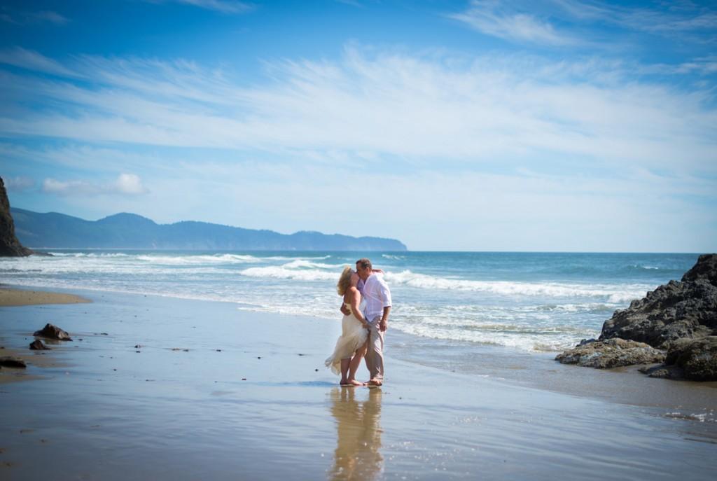 Wedding couple on beach Oceanside Oregon