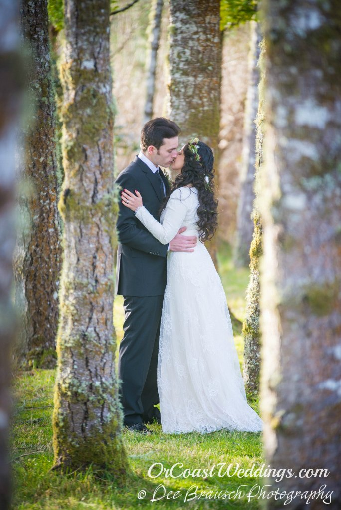 Elopement couple kissing in trees at Sandlake