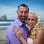 Shawn and Michelle with Haystack Rock on their Oregon Coast beach wedding