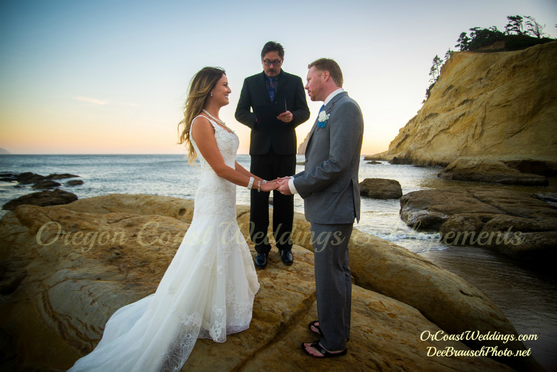 Oregon Coast Officiant standing on rock performing  ceremony