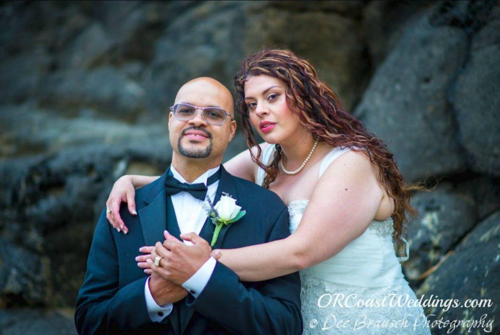 bride and groom embracing on Oregon coast