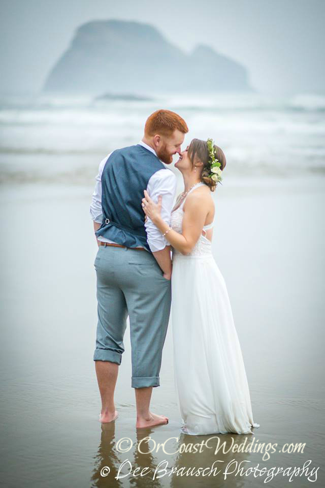 Oregon coast elopement Bride and groom on Oregon beach kissing