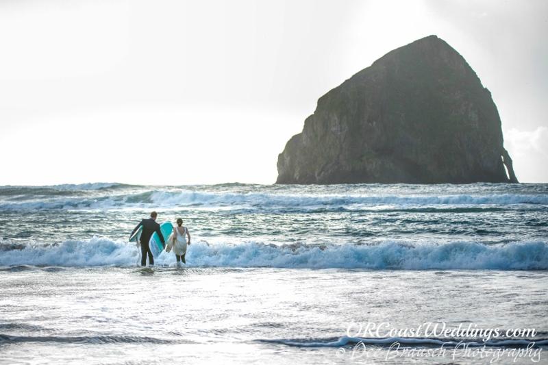 Joseph & Meryl surfing on their wedding day