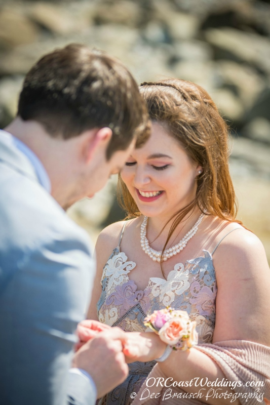 Exchanging Rings at a Secret Beach Elopement